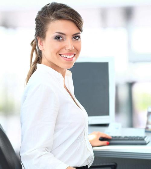 Woman At Keyboard - Employment Screening FAQs